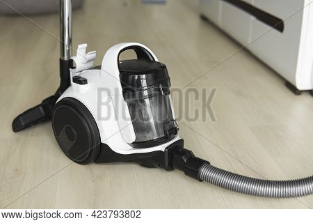 Bagless Cyclone Vacuum Cleaner On A Laminate. Electrical Apparatus That By Means Of Suction Collects