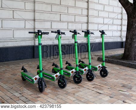 Electric Scooter Rental In City Center. Scooter Sharing For Tourists And Citizens. Using Sharing App