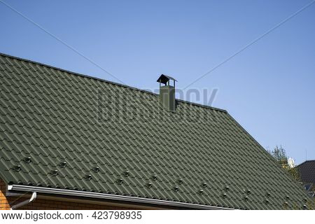 Green Corrugated Metal Profile Roof Installed On A Modern House. The Roof Of Corrugated Sheet. Roofi