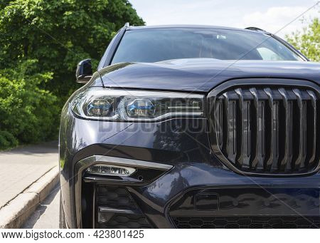 Close-up In Front Of A New Black Prestige Car, Expensive Status Car Suv, Headlights, Radiator Grille