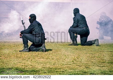 Abakan, Russia - August 21, 2018: A Police Swat Team Operation Training. Blur. Smoke. Motion.