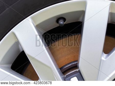 Rusty, Defective Brake Disc With A Shoulder On The Edge. Worn Brake Disc Concept, Brake Failure, Mac