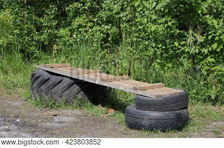 Improvised Makeshift Bench Made Of Wooden Planks And Car Tires