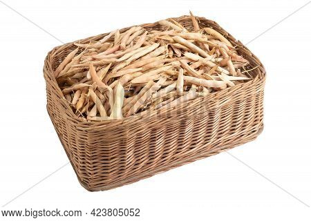 Dry Bean Pods In A Wicker Basket On A White Background, Isolate, Close-up