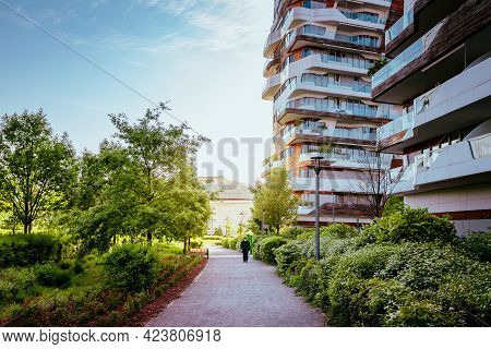 Milan, Italy - May 2021: Elderly Walking Under The Modern Apartments Of Citylife, A District Of Mila