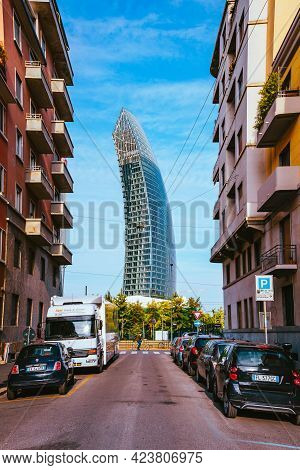 Milan, Italy - May 2021: View Of The New Skyscraper Through A Street With Houses And Buildings In Th