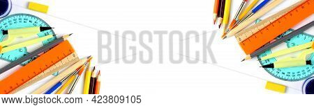 Stationery And School Goods Isolated On White As Wide Banner, School Or Home Education Concept. Top