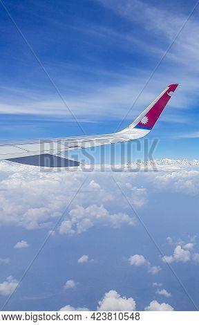 Nepal Airline Aircraft Flight Above Highest Mountain Mount Everest Himalayas.