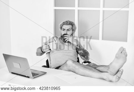 Barefoot Guy Working From Home. Man Working On Laptop At Home. Comfortable Workplace. Developer Work