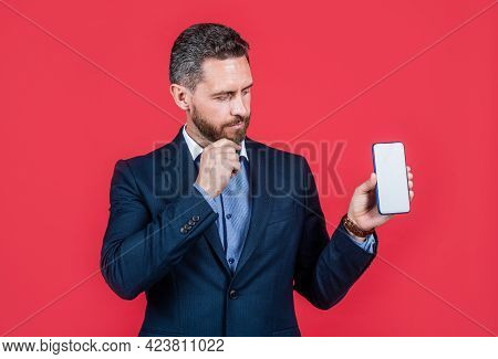 Handsome Man In Formalwear Presenting Product Of Smartphone, Advertisement