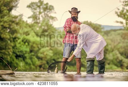 Hobby And Recreation. Success. Fishermen. Successful Catch. Retired Businessman. Male Friendship. Go