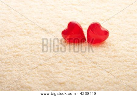 Two Red Hearts On Yellow Towel