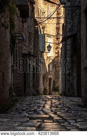 Narrow medieval paved street in old town of Split in Croatia