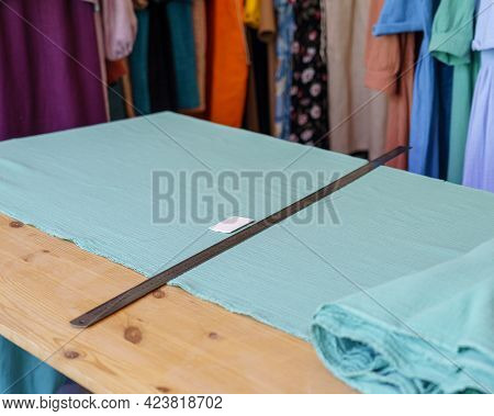 Workplace Of Seamstress Or Tailor With Cloth Square, Metal Ruler And Piece Of Soap For Marking Cloth