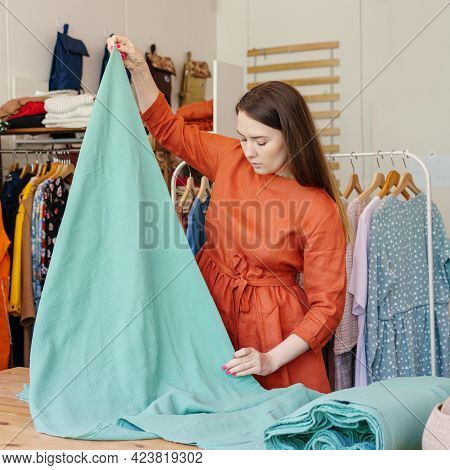Professional Woman Fashion Designer With Material For Creating Fashionable Clothes At Own Atelier, W