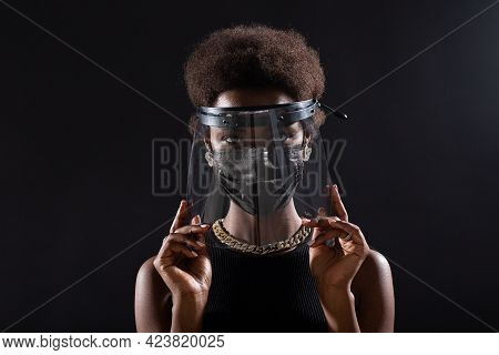 African American Woman In Black Medical Face Mask And Transparent Protective Face Shield. Safety Con
