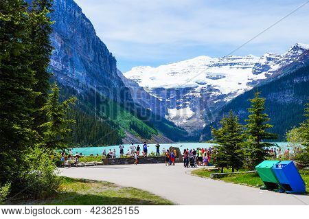 Lake Louise, Canada - July 2, 2014: Visitors At Glacier-fed Lake Louise In Banff National Park With