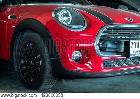 Bangkok, Thailand - 06 Jun 2021 : Close-up Of Headlights, Wheel, And Rim Of Red Car. Selective Focus