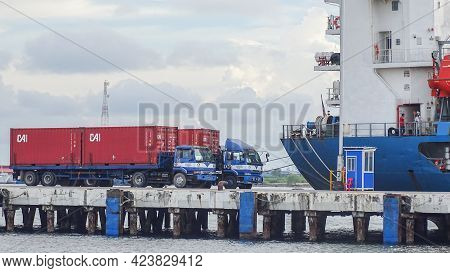 Labuan,malaysia-feb 10,2021:container Trucks With Containers Parked In The Shipping Port Of Labuan F