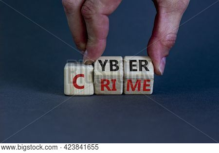 Cyber Crime Symbol. Businessman Turns Wooden Cubes With Words 'cyber Crime'. Beautiful Grey Backgrou