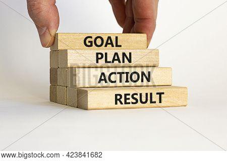 Goal, Plan, Action, Result Symbol. Wooden Blocks Form The Words 'goal, Plan, Action, Result' On Beau
