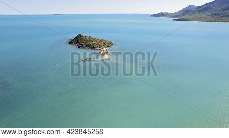Drone Aerial Over A Small Uninhabited Island Offshore In The Coral Sea At Cape Gloucester Australia