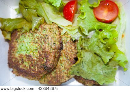 Vegetable Cutlets With Vegetables Against White. Nobody.