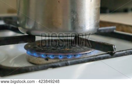 Dirty Gas Stove In The Kitchen For Cooking With Vegetable Oil Stains And Burnt Food Debris On The Su