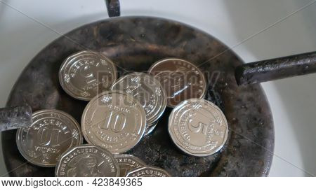 Ukrainian Hryvnia On A Gas Water Heater Without Fire. Gas Stove With Money. Conceptual Image Of A Ri