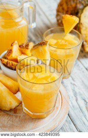 Tasty Pineapple Juice In Two Glasses With Pineapple Slices. Fresh Natural Pineapple Cocktail And Jui