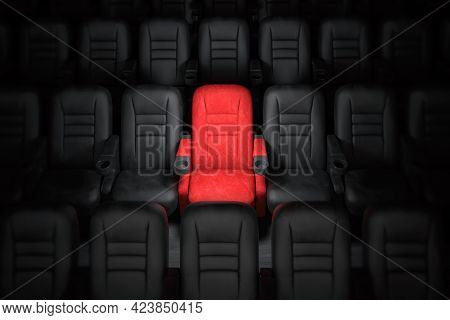 One red empty seat among others black seats in cinema hall. 3d illustration