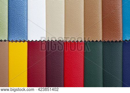 Background Image - Stripes Of Multi-colored Factual Leather.