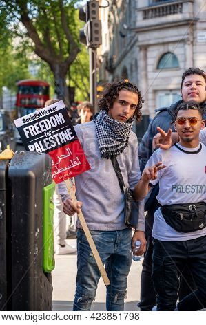 London, Uk - May 29, 2021: A Portrait Of A Protestor Posing For A Photo And Holding A Sign Saying 'f
