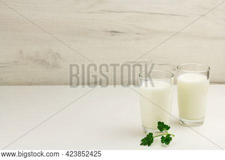 Kefir, Ayran, Yoghurt In Glasses With Greens
