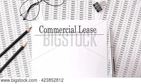Paper With Commercial Lease On A Table With Chart