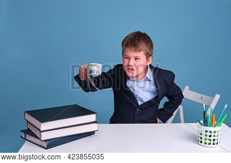 Pupil Boy Junior With A Sly Expression On His Face And Money In His Hands
