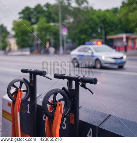 Electric Scooter Rental Service And Police Car Rental