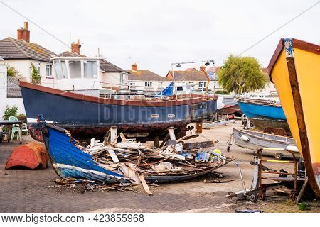 The Boat Cemetery. A Group Of Wrecks Of Old Wooden Fishing Boats On The Quay In Poole Town, Dorset,