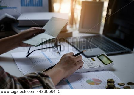 A Man With A Savings Account Calculates The Amount Of Money He Can Save This Year. Real Estate And A