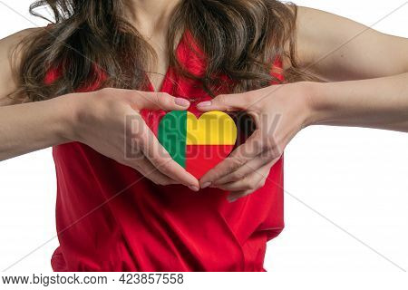 Love Benin. The Woman Holds A Heart In The Form Of The Flag Of Benin On Her Chest. Concept Of Patrio