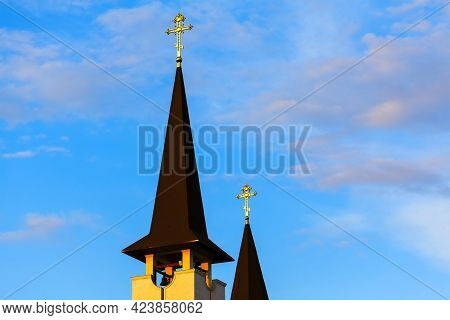 Conical Church Spire With Golden Cross On The Top . Religious Architecture