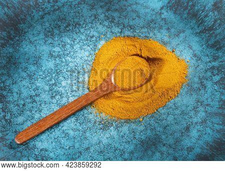 Curcuma Longa - Organic Turmeric Powder In Wooden Spoon