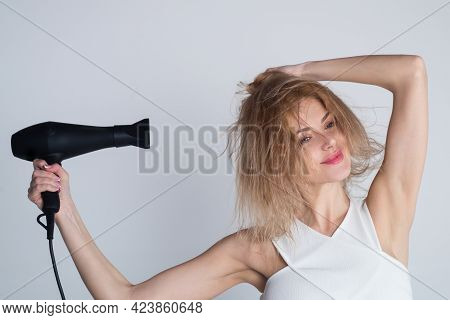Beautiful Girl Blow Drying Her Hair, Hairdryer. Young Woman With Drying Hair With Hair Dry Machine A