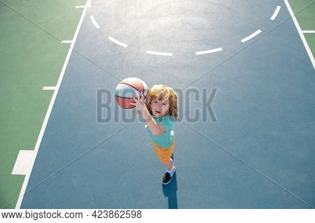 Kids Playing Basketball, Outdoor On Playground. Child Sport Activity. Kid Sports Man.