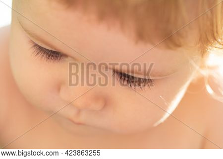 Kids Portrait, Close Up Head Of Cute Baby Child With Long Lashes, Cropped Face. Macro Eyelash.