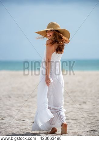 Summer Model Posing On The Beach. Summer Dress Fashionable Woman Clothes. Young Beautiful Hipster Wo
