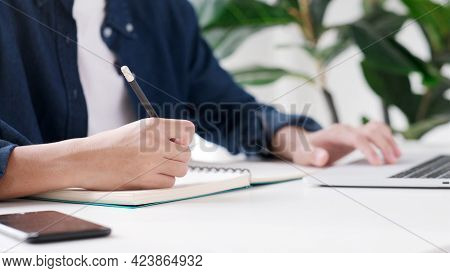 Online Education Learning, Work From Home, Man Hand Writing On Notebook While Using Laptop Computer,