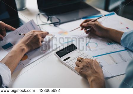 Business People Adviser Meeting To Analyze And Discuss The Situation On The Financial Report In The