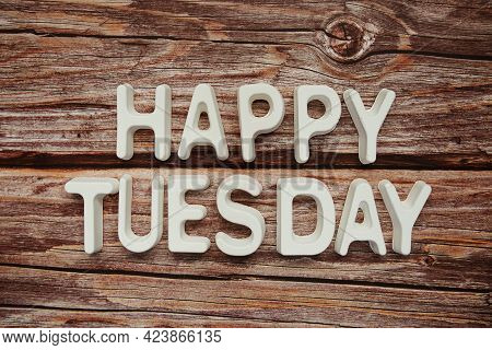 Happy Tuesday Text Message On Wooden Background