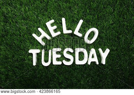 Hello Tuesday Alphabet Letter On Green Grass Background